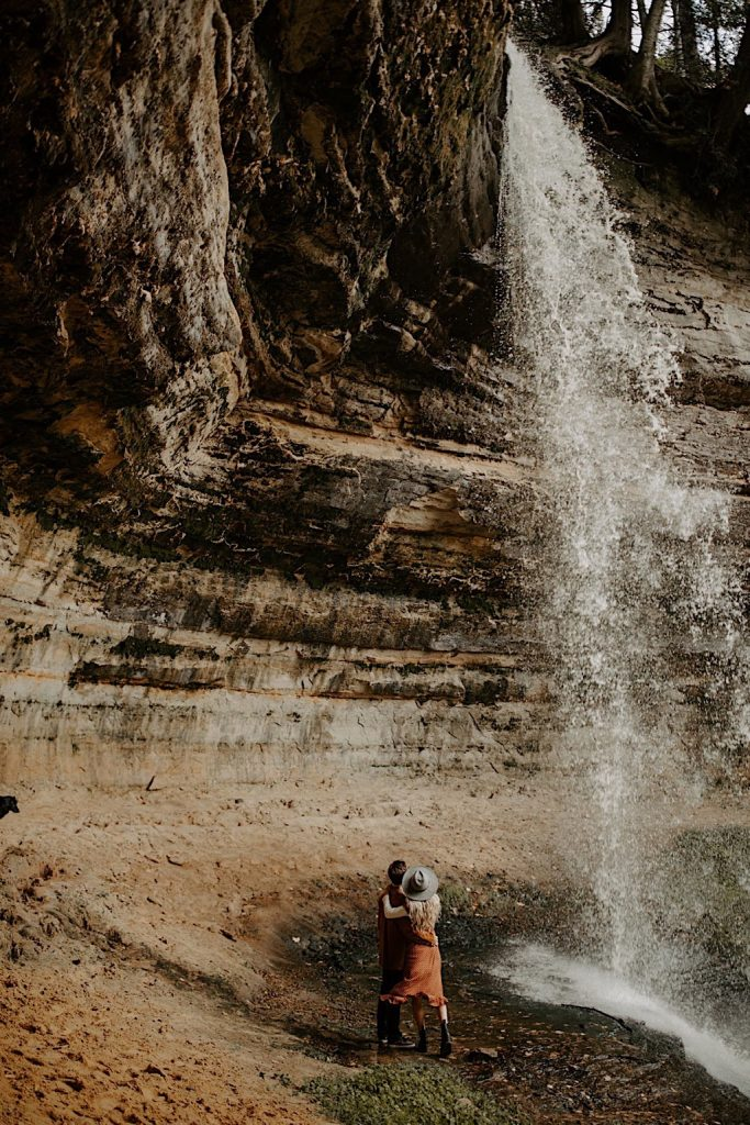 Waterfall couples adventure photos in Michigan